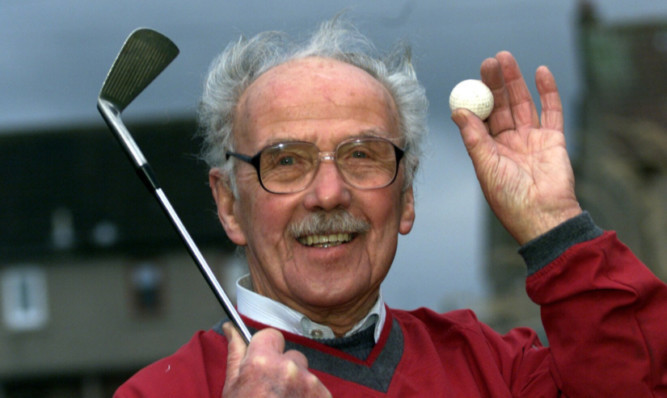 Mr Suttie was a keen golfer and is seen celebrating a hole-in-one.