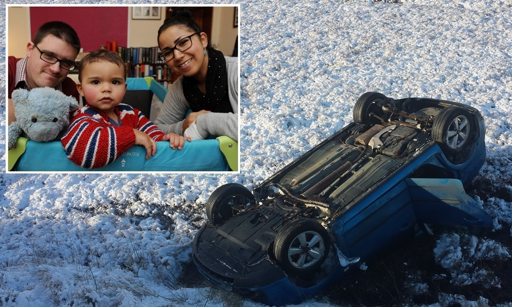 Fidaa and husband Alexander, from Montrose, were travelling to Inverness with son Zakaryah on Saturday morning.  They chose to take the scenic route via Crathie and Tomintoul but encountered snow on the B976 road just beyond Ballater. When the car couldnÕt climb a steep hill, they turned around. However, on the way back down they hit black ice and ploughed straight on.  The car hit a snow pole before going Òstraight over the edgeÓ and flipping over, coming to rest in a water-filled hollow.Pictured The up-turned Ford FocusPic Newsline Media