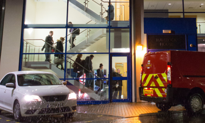 Havelock Europa staff leave their Kirkcaldy HQ after the news of the contract loss on November 17.