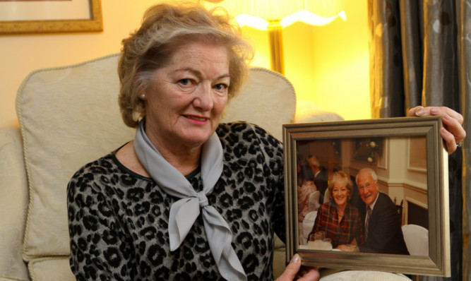 Elizabeth Birrell with a photograph of herself and her late husband Ian.