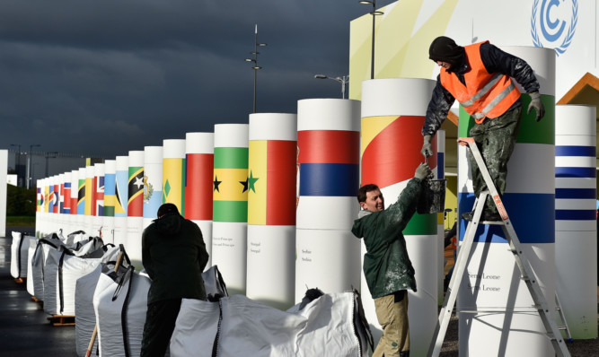 Workers make final preparations for the COP21, Paris Climate Conference site in Le Bourget, France.  The 21st United Nations Conference on climate change will run from from November 30 to December 11.