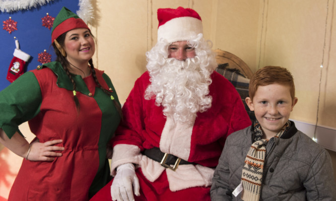 Santa was kept busy in his Kirriemuir grotto.