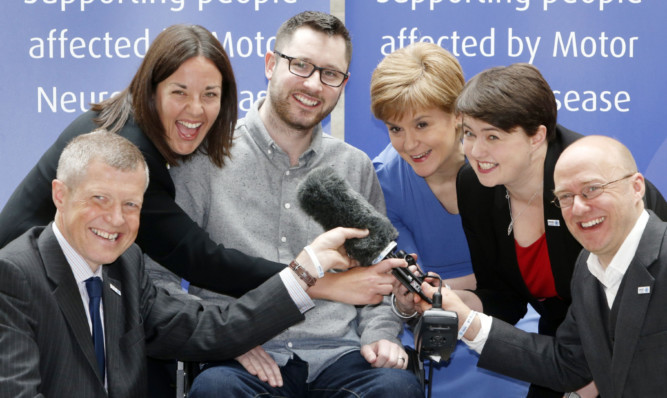 Scotland's political leaders, pictured with Kirkcaldy-born MND campaigner Gordon Aikman, will face off at a Dundee University debate