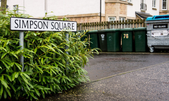 The bin area at Simpson Square which residents claim has been left a mess.