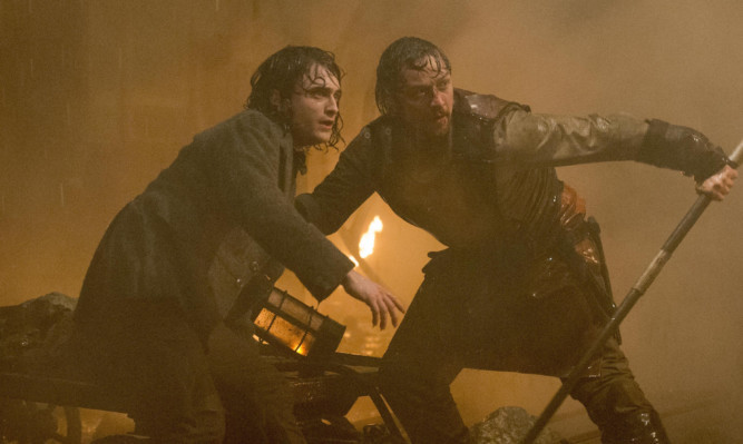 Daniel Radcliffe as Igor and James McAvoy as Frankenstein.