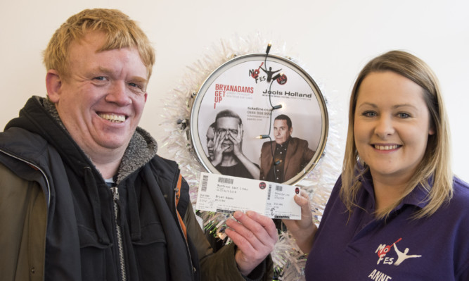 Jason Lindsay was one of the first in the queue to get his tickets from MoFest's Anne Jenkins.