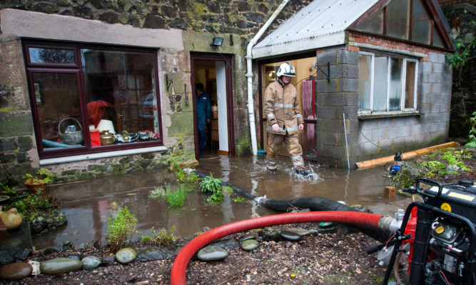 Scottish Fire and Rescue crews helped to pump water from the flooded homes in Glenfarg.