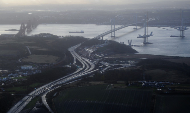 Deserted roads leading up to the Forth Road Bridge.