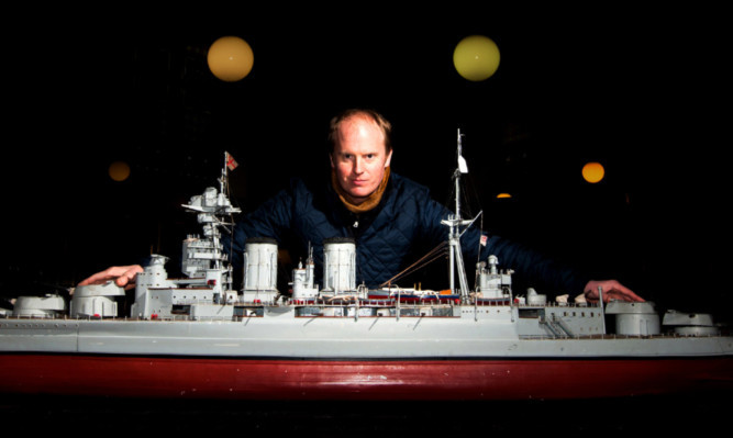 Auctioneer Nick Burns with the replica HMS Hood.