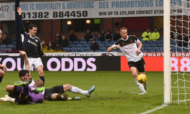Aberdeen striker Adam Rooney prods the ball into the empty Dundee net.