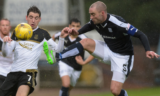 James McPake (right) challenges Aberdeen's Kenny McLean.