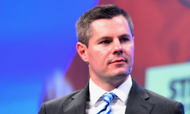 Transport Minister Derek Mackay faced calls for an inquiry at Holyrood.