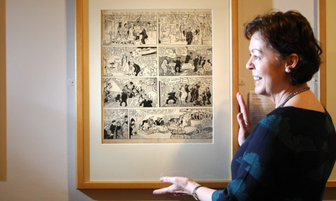 Susan Keracher with Broons artwork by Dudley D. Watkins.