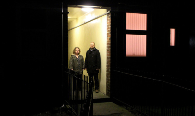 Councillor Kevin Cordell and resident Laura Hynd in one of the lit parts of Bowmans Lane, Broughty Ferry.
