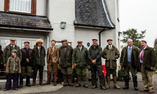 Councillor Bob Myles, chairman of Glenesk Trust (far right) at the Retreat, welcoming the shooting party which helped raise vital cash for the venue.