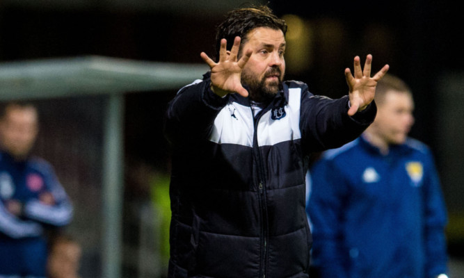Paul Hartley on the touchline at Dens.