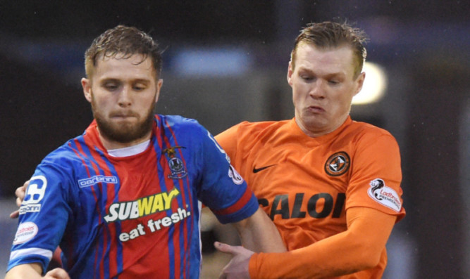 Billy Mckay battles with Danny Devine.