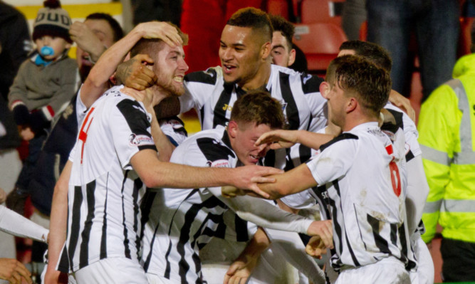 Dunfermline players congratulate Shaun Rooney, left, after he scored the only goal of the game against Stenhousemuir.
