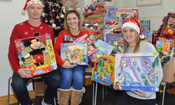 Cupar-based social worker Victoria Leonard who co-ordinates Toy Drive, a charity set up by her three years ago. Pictured (from left)  Lee Shaw, Victoria Leonard and Laura Lumsden.