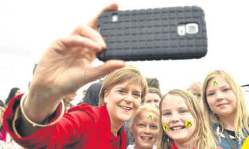 First Minister Nicola Sturgeon says she has posed for hundreds of thousands of selfies this year.