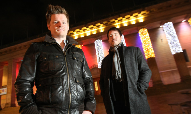 Film-makers Stuart Hamilton and Liam Johnston outside the Caird Hall in Dundee where The Proclaimers appeared on Saturday night.