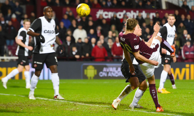 Hearts' Gavin Reilly grabs his team's first goal.