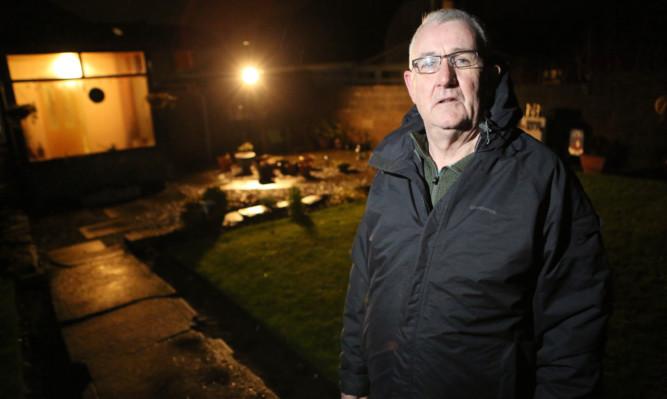 Alex Macfarlane says his garden regularly floods.