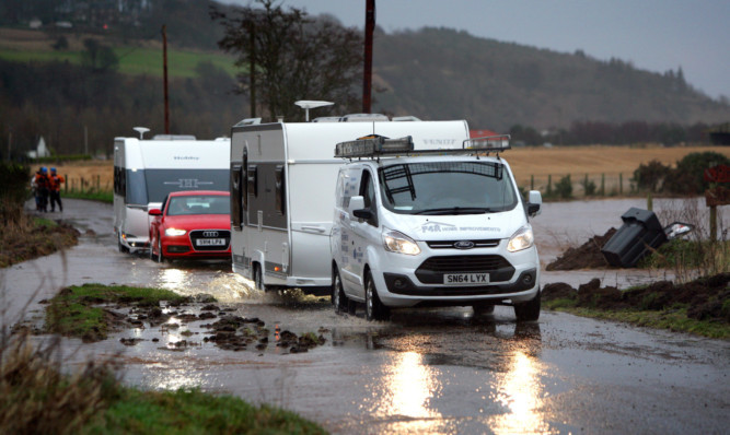 Caravans leaving the Travellers site at North Esk Park as flooding hit the area.