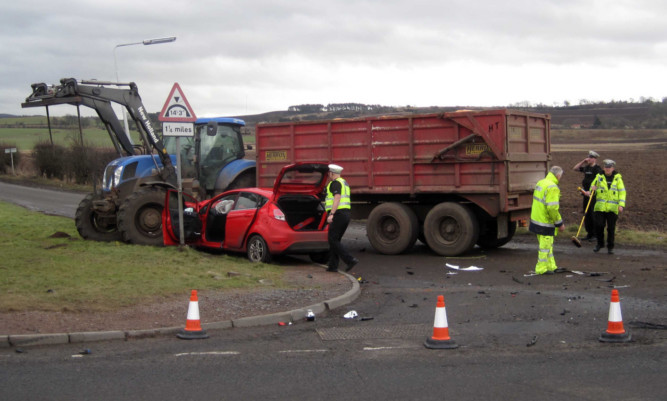 The tractor collided with the car on the A92 near Freuchie. Catherine Armitt died the following day.