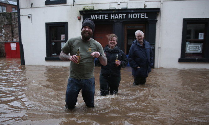 Locals found a way to cope during serious flooding in Dumfries on Wednesday.