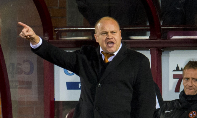 Mixu Paatelainen makes a point during the Hearts match.