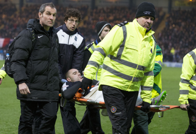 Dundee's James McPake is stretchered off.