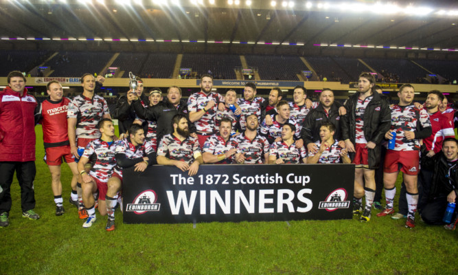Edinburgh's squad celebrate after winning the 1872 Cup at Murrayfield.