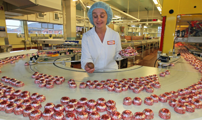 Maria Henderson tasting and testing Tunnocks teacakes. However, the firm has been criticised by some Nationalists for branding its products British rather than Scottish.