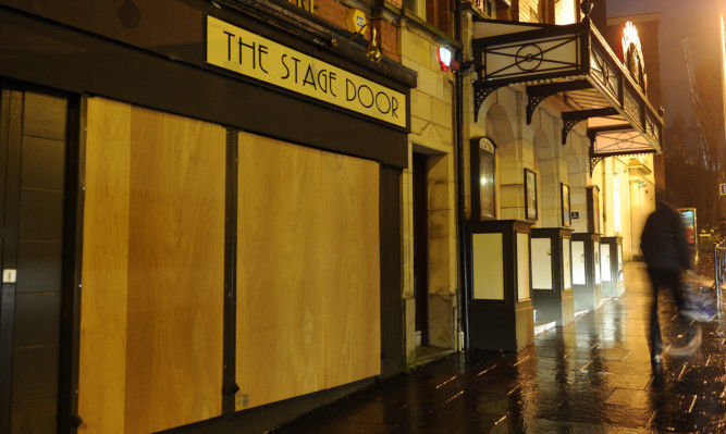 Alhambra Theatre says its boarded-up windows are merely a security measure during a brief January break for staff.