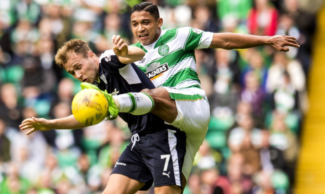 Emilio Izaguirre (right) challenges Greg Stewart in a previous clash between the teams.