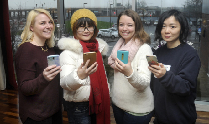 Emily with Kay (Hong Kong), Sophie (France) and Tao (Shanghai).
