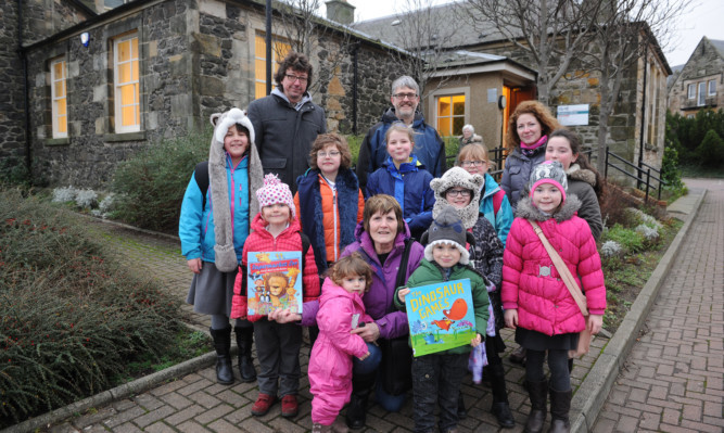 Youngsters and parents outside Kinghorn Library which will remain open for at least a year.