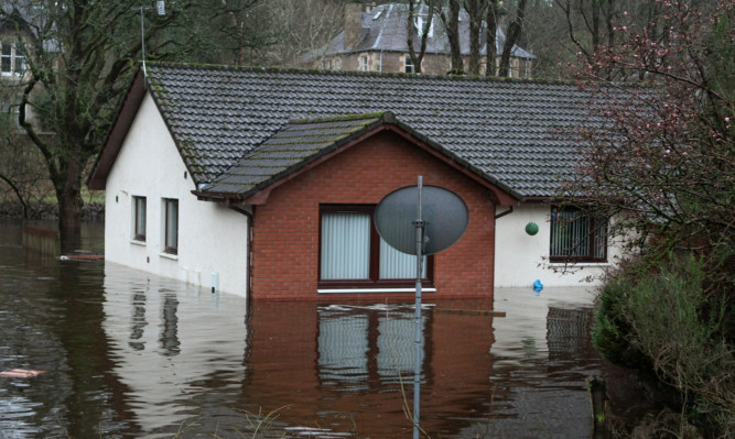 This house in Dunkeld is one of many across Scotland affected by flooding in recent weeks.