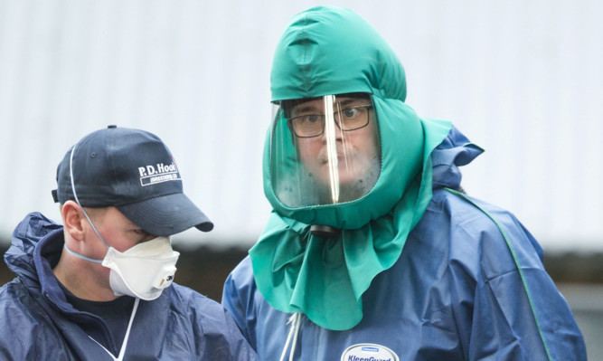 Disease control experts at the scene on Monday.