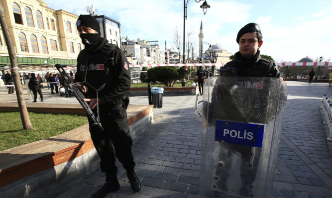 Policemen secure an area at the historic Sultanahmet district, which is popular with tourists, after an explosion in Istanbul.