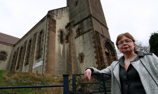 Kathleen Mands, chairwoman of Craigiebank Association, outside the church the group wants to knock down so that a new building can be constructed on the site.