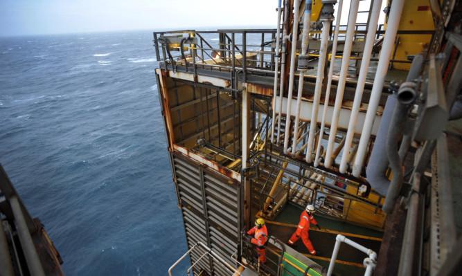 Workers on BP's ETAP oil platform in the North Sea.
