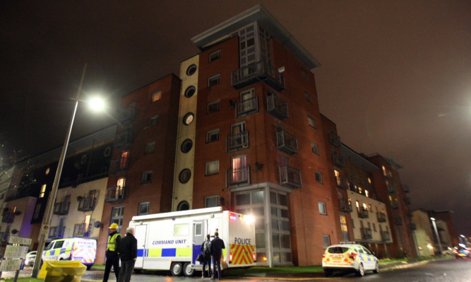 Police co-ordinating the evacuation of the Gourlay Yard flats.