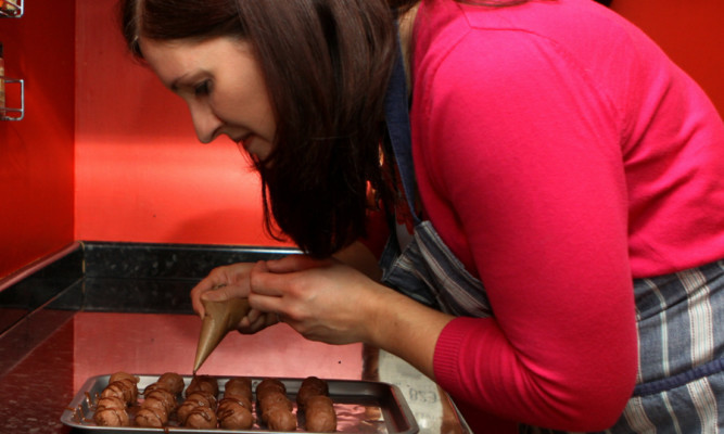 Morag Hogben of Watson's Chocolates at work in the kitchen of her Springfield home