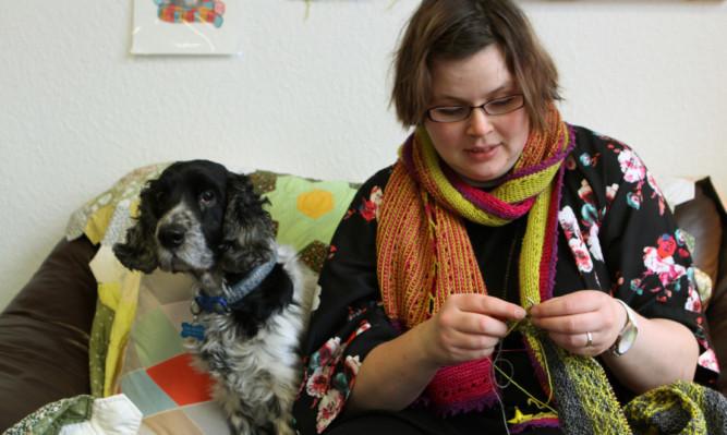 Fluph shop owner Leona-Jayne Kelly, with her dog Arthur looking on.