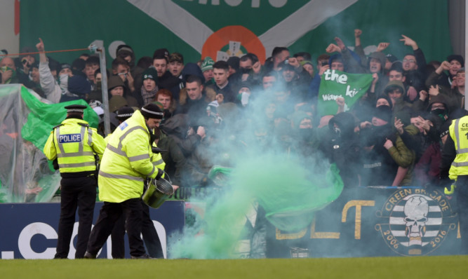 A flare was thrown on to the pitch ahead of the Stranraer v Celtic match last weekend.