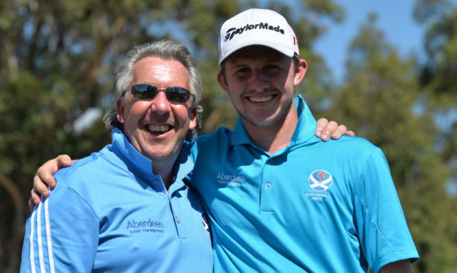 Connor Syme with Scotland national coach Ian Rae, who has been following the Drumoig player all week.
