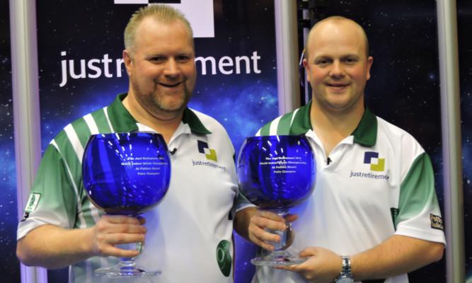 Darren Burnett and Stewart Anderson with their world indoor bowls titles.