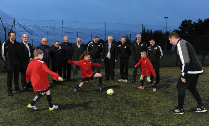 Performance Director of the SFA Brian McClair, Executive Committee Member Cllr Mark Hood and Chair of the Glenrothes Area Committee Cllr Bill Brown watch members of the Fife Football Performance Academy show off their skills.